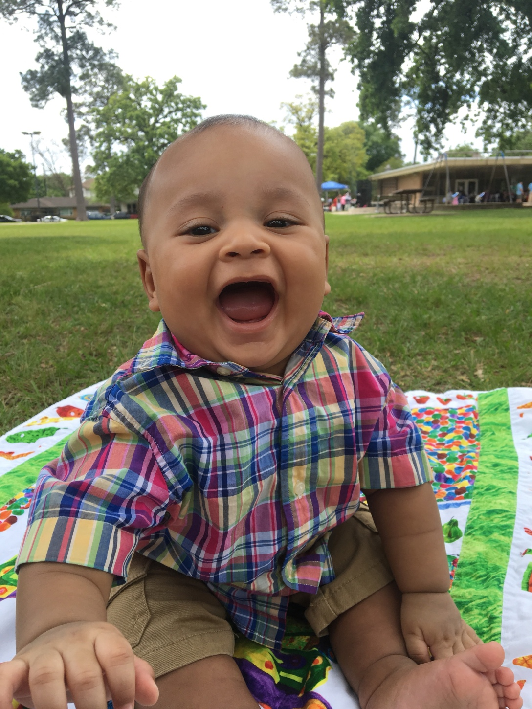 Buddha laughing away on Easter in his fun multicolored plaid Polo Ralph Lauren shirt.