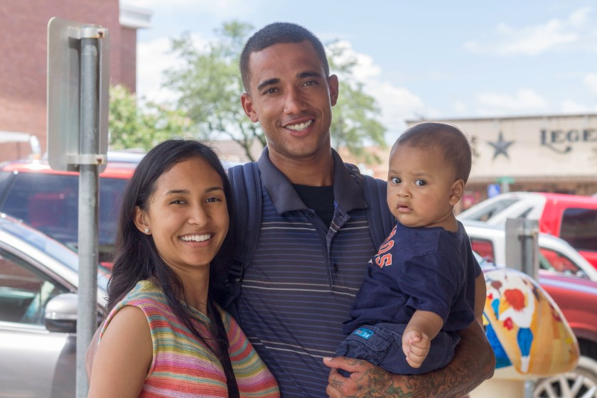 My son with his parents. Baby is wearing a Houston Astros shirt and mom is wearing a Ralph Lauren knit. This picture was taken with a Canon Rebel T3